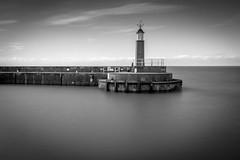 Watchet Lighthouse. (ian.emerson36) Tags: sea summer lighthouse port coast blackwhite harbour peaceful somerset calm coastline serene glassy hoya watchet ndx400