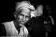 Spot Light (Neeraj Shutterbug) Tags: old light portrait bw india canon homeless poor streetphotography walkingstick stick aged wrinkles efs ef rishikesh cwc northindia portraitphotography bouncedlight