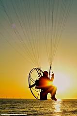 Sunset seat (snapnikonnick) Tags: sunset shadow man beach water liverpool waves power aircraft glider seashore crosby