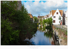 Bruges (Den Boma Files) Tags: old city travel blue sunset sky white house holiday reflection building tree brick green heritage history tourism nature water architecture river town canal europe european cityscape belgium brugge bluesky nobody nopeople medieval historic unesco bruges flanders cloudes