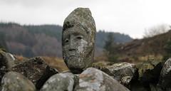 Highlander (Yansk!) Tags: wild art nature face statue stone wall forest scotland head stonework hills lichen weathering