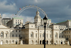 View of Horse Guards Parade, Whitehall, with the London Eye in the distance, London, England (Roberto Herrett) Tags: city uk travel light england sky urban white storm london english tourism k horizontal architecture clouds buildings dark outside europe icons unitedkingdom britain streetlamp famous capital sightseeing cities dramatic londoneye stormy places tourist architectural historic lamppost u historical british lit iconic sights attractions locations courtyards stockphoto exteriors rherrettflk