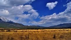 In front of the southeastern foothills of the Himalayas, Lijiang, Yunnan, China (flowerikka) Tags: china sky mountains clouds cn germany landscape bluesky himalaya yunnan steppe lijang