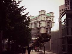 Shimbashi, Tokyo (KaeriRin) Tags: urban japan architecture skyscraper pen tokyo sightseeing olympus seeing metropolis sight modernarchitecture 25mm bigsight urbanjapan urbantokyo 25mm18 epl5