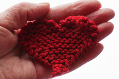 A beautiful heart can bring things into your life that all the money in the world couldn't obtain. (katerha) Tags: red love heart knit valentine heartinhand beautifulheart knittedheart