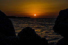Staring at the Sun (Pablo Margulies) Tags: ocean sea sky orange sun seascape color beach water landscape daylight rocks europe waves pentax dusk stones greece shore rodos rhodes k5 rhodos waterscape rdos smcpfa43mmf19