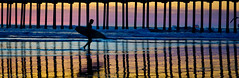 Surf City (Greg Adams Photography) Tags: california travel winter sunset beach pier surf pacific dusk surfer silhouettes calif wharf surfboard southerncalifornia seashore huntingtonbeach 2014 hhsc2000
