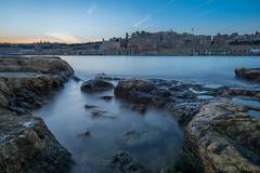 Sunset over Valletta (woozy95) Tags: ocean city sunset sea sky sun water rock bay long exposure malta valletta