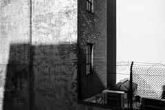 150418_SAM_1127 (Jan Jacob Trip) Tags: light shadow bw usa white newyork black brick window wall fence us wire unitedstates manhattan vs barbed highline contras
