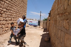 Children in West Aleppo carry Ramadhan provisions home (Ummah Welfare Trust) Tags: poverty charity children war islam east aid hunger syria middle humanitarian humanitarianism