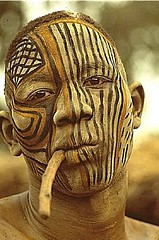 Sudan. The painted face masks of the Kau Nuba // photo by  Leni Riefenstahl (mike catalonian) Tags: africa portrait color male face photography sudan nuba kau northernregion leniriefensthal