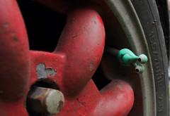 mini with an alien (preecei) Tags: car wheel paint outdoor alien chip nut dustcap