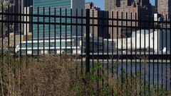 Freedom, Restrictions, Bars, No Bars U.N. - IMGP4197 (catchesthelight) Tags: park skyline buildings manhattan bluesky views rooseveltisland metaphors unbuilding newyorkcityny springvisit fencebars waterfrontpromenades franklindrooseveltfourfreedomspark april2016