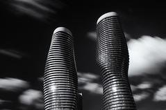 Absolute Towers Long Exposure (Chris Noronha) Tags: longexposure sky bw white ontario black architecture clouds buildings mono nikon towers mississauga absolute d90 chrisnoronha
