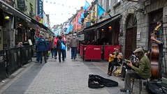 Music on Quay Street (mcginley2012) Tags: street galway ireland cameraphone lumia650 crowds flags galway2020 musicians guitar doublebass buskers