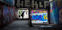 Graffiti Tunnel (tanepiper) Tags: morning blue shadow red england orange london yellow outdoors colours grafitti unitedkingdom tunnel waterloo complexity framing southlondon lambeth