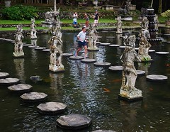 a run on the pond (SM Tham) Tags: boy people bali water indonesia outdoors island pond asia statues running tourists watergardens steppingstones fountains waterfeature waterpalace karangasem tirtagangga amlapura gardenstosee
