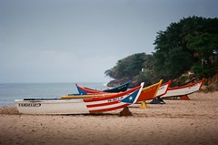 Yolas (small fisherman boats) (GOJR.) Tags: seascape nikonfm2n landscape 135 puertorico aguadilla crashboat beach analog film kodakektar100 nikon50mmf14