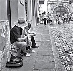 Musico Callejero (Street Musician) (Samy Collazo) Tags: bw musician 6x6 film smile hat kodak guitar guitarra streetphotography bn cobblestones negative squareformat aviary pelicula sonrisa sombrero negativo adoquines lightroom streetmusician musico kodaktrix400 rolloffilm kodakd76 75mmf35 fotografiacallejera musicocallejero formatocuadrado lightroom3 niksilverefexpro2 rollodepelicula eastar6x6china