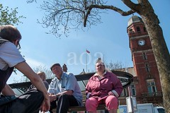G22_0224 (bandashing) Tags: street friends light shadow summer england bus sunshine bench manchester chat market talk stall bluesky clocktower hyde shade sit townhall civicsquare northern sylhet bangladesh sunnyday socialdocumentary flatcap aoa tameside bandashing akhtarowaisahmed