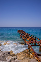 Rusty pier at the day (aleksey_kondratiev) Tags: turkey fethiye oludeniz mediterranean sea water blue wave waves seashore rocks sky pier rust