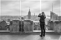 Snapshot (John St John Photography) Tags: cameraphone newyorkcity blackandwhite bw woman newyork blackwhite cityscape worldtradecenter midtown smartphone empirestatebuilding topoftherock photographing candidphotography midtownmanhattan 30rockefellercenter srteetphotography peopleofnewyork