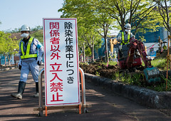 Decontamination work no entry sign in front of workers who remove top soil contaminated by nuclear radiations after the daiichi nuclear power plant explosion, Fukushima prefecture, Iitate, Japan (Eric Lafforgue) Tags: 2people adultsonly asia atom atomic catastrophe colourpicture contaminated contamination daiichi danger dangerous decontaminationwork ecology energy environment environmental forbidden fukushima fukushimaexplosion fukushimaprefecture guidance hazard health horizontal iitate irradiate japan japan161536 men nuclearaccident nuclearindustry onlymen outdoors pollution prohibition radiation radioactive radioactivity risk school signboard soil twopeople unsafe workers giappone   japo japonia japonsko japonya jepang jepun  oo