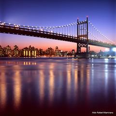 Triborough Bridge (Rafakoy) Tags: city nyc longexposure urban ny newyork 6x6 tlr water colors skyline night mediumformat reflections river lights cityscape fuji harlem manhattan slide queens eastriver astoria epson fujifilm positive eastharlem e6 rfk astoriapark 80mm triborobridge reversal triboroughbridge yashinon yashicamat124 film120 fujichromevelvia100 yashinon80mmf35 epsonperfectionv600 robertfkennedyrfkbridge