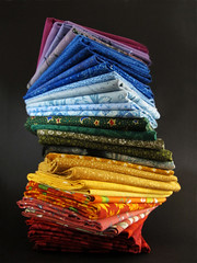 Fabric Tower in Rainbow Colors (Batikart) Tags: blue red inspiration black macro green tower art colors yellow closeup canon germany table geotagged fun creativity deutschland colorful europa europe pattern colours order quilt artistic background joy multicoloured row fantasy pile dr