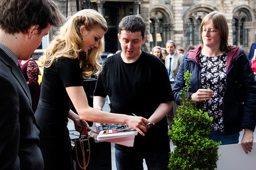 Natalie Dormer signing an autograph at the opening night party of the 67th Edinburgh International Film Festival