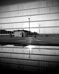 One Courthouse Square (reflected) (HamWithCam) Tags: atlanta blackandwhite bw reflection puddle atl dec hamwithcam hwc decatur 22mm canonnm