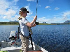 Toby Biddell looks under pressure to catch his first brown trout.