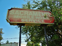 Sacramento Mobile Home Service (rickele) Tags: faded vacant barbedwire sacramento rv ghostsign emptylot northsacramento plasticsign motorhomeservice