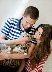 happy young couple with their cat (Lerenka) Tags: family boy two people woman pet house man male love home girl beautiful smile animal female cat fun happy bed bedroom kitten couple play affection joy young happiness husband domestic laugh attractive wife rest casual cheerful joyful embrace affectionate tender tenderness communicate relations caucasian
