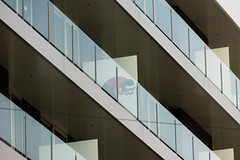'The Repairman' (Canadapt) Tags: abstract man reflection building portugal angle graphic balcony line repair canadapt