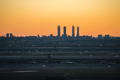 Madrid-Barajas Airport with city skyline in background at sunset (macgyver912) Tags: madrid sunset españa landscape four cuatro 4 towers terminal business area goldenhour 4s satelite torres comunidaddemadrid chamartin cbta