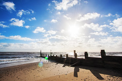Shadows (Jeremy Vickers Photography) Tags: blue sea sky sun beach water sunshine clouds coast suffolk sand flare british southwold groins canonefs1022mmf3545usm canoneos40d