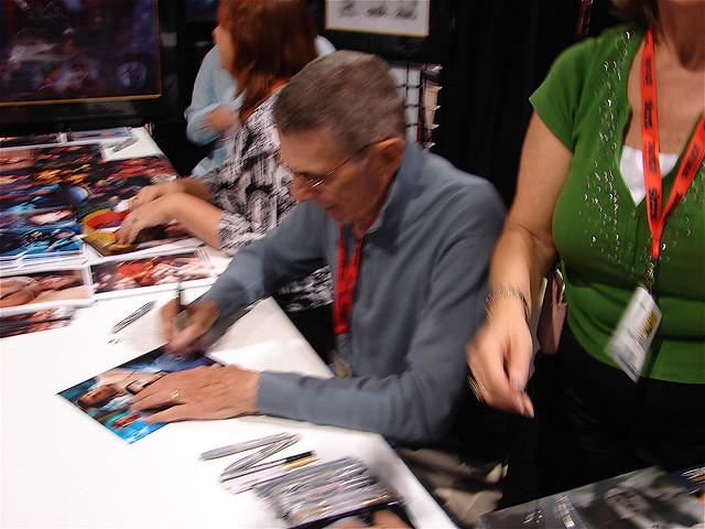 Actor Leonard Nimoy signs autographs.