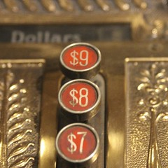 Dollars (Read2me) Tags: numbers old antique cashregister she cye round circles gold red macro closeup friendlychallenges thechallengefactory gamewinner pregamewinner