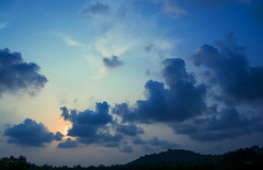 hid behind the clouds ([s e l v i n]) Tags: blue sunset sky cloud sun india clouds landscape hideandseek traintravel southindia selvin