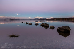 Milarrochy Bay (GenerationX) Tags: pink blue moon mountains water sunrise reflections landscape dawn mirror bay scotland still rocks unitedkingdom scottish neil calm moonlight trossachs lochlomond barr luss inchlonaig millarochy beinnime