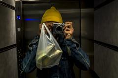 Banana (Levan Kakabadze) Tags: selfportrait valencia yellow spain elevator streetphotography banana colon le1strph