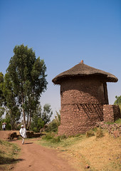 Traditional house for the monks, Amhara region, Lalibela, Ethiopia (Eric Lafforgue) Tags: africa travel roof house color building tree men home vertical architecture outdoors photography day exterior outdoor stones traditional straw monk unescoworldheritagesite thatch daytime christianity copyspace thatchedroof ethiopia adults 2people twopeople thatched lalibela hornofafrica eastafrica thiopien etiopia abyssinia ethiopie etiopa ruralscene buildingexterior fulllenght nonurbanscene  etiopija ethiopi  tukul etiopien etipia  etiyopya  builtstructure amhararegion         semienwollozone ethio163634