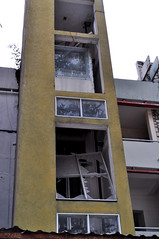 Wrong flaw (Roving I) Tags: windows abandoned broken glass vertical buildings vietnam damage elevators danang lifts