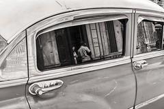 chatting at the door (Gerard Koopen) Tags: street door people woman man reflection classiccar fuji candid cuba streetphotography santaclara fujifilm talking chatting frontdoor straat 2016 straatfotografie x100t gerardkoopen antiquecubancar