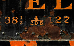 Fractionation (Junkstock) Tags: aged artifact artifacts black color closeup corrosion corroded california decay decayed distressed dark graphics graphic iron industrial industry locomotive machinery machine number numbers old oldstuff patina paint peelingpaint perris relic rust rusty rustyandcrusty rusted railroad textures texture typography type transportation transport trains train vintage weathered rivets