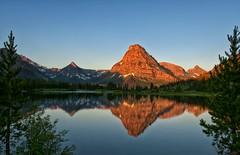 Magic Mountain (Philip Kuntz) Tags: sunrise reflections dawn montana glacier explore glaciernationalpark daybreak twomedicine blackfeet blackfoottribe praylake mtsinopah kitfoxmountain