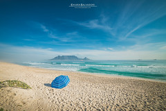 Blue Spring (Chiara Salvadori) Tags: ocean africa travel winter light sea people sun seascape beach colors landscape southafrica spring scenery surf outdoor wave capetown atlantic traveling tablemountain capepeninsula sudafrica bigbay