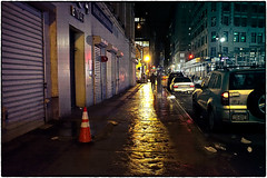 Through a river of gold, he strode into abyss (henk.sijgers (on when I can)) Tags: street city nyc light red urban orange white ny black color wet water yellow night photoshop reflections concrete gold cityscape fuji purple availablelight nik acr asphalt textured x70 18mm aspectratio32 layermask apsc digitalsensor xtrans lr5 colorefex2 macphun piccure 35mmaov28mm noiselesspro 18mmf28fujinon