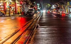 Red Light District (DobingDesign) Tags: sanfrancisco california red urban reflection cars wet lines metal puddle us photo nightshot unitedstates stripes citylife streetphotography citylights shops vehicle motor tramlines moist carheadlights nightcolours